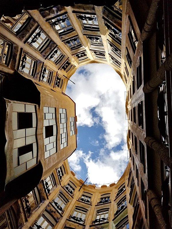 view looking up at the sky from inside the courtyard of a building