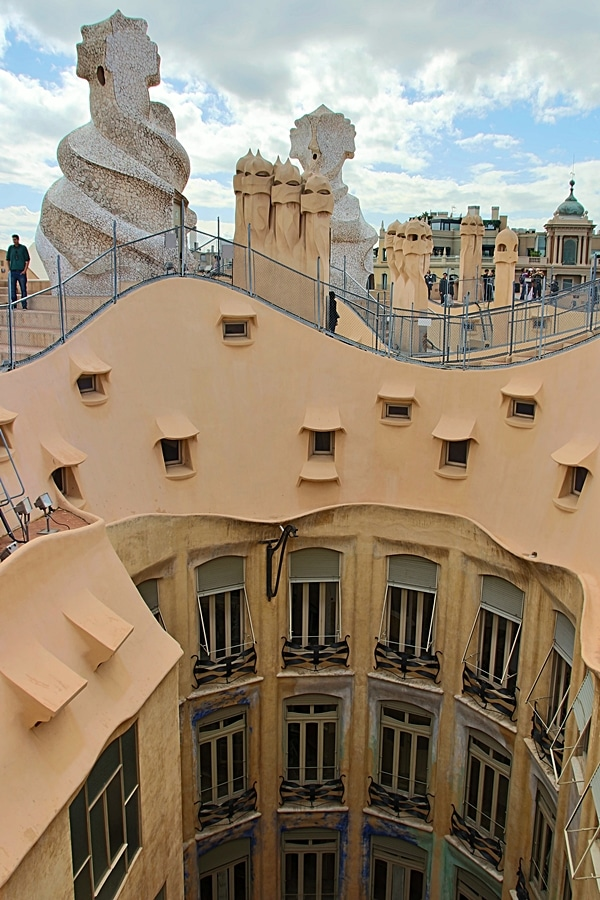view across the courtyard opening of the Casa Milà rooftop