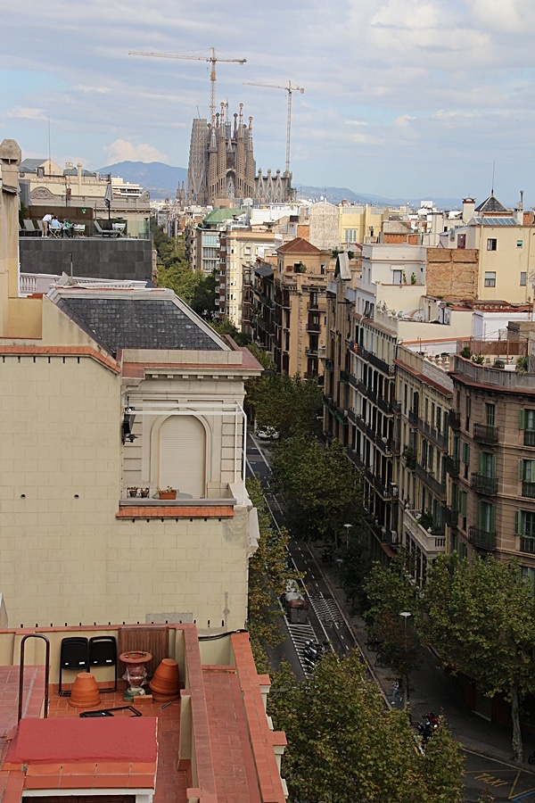 rooftop view of a Barcelona street with Sagrada Familia in the distance