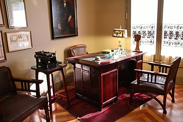 an office with a large wooden desk