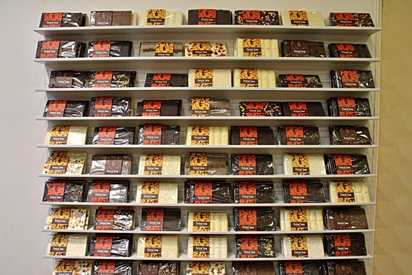 A close up of bars of chocolate on display for sale