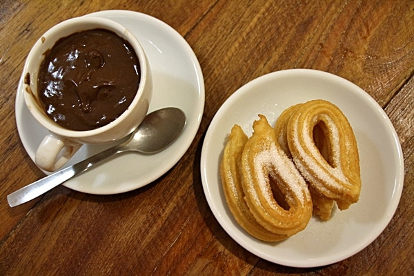 overhead view of churros and chocolate