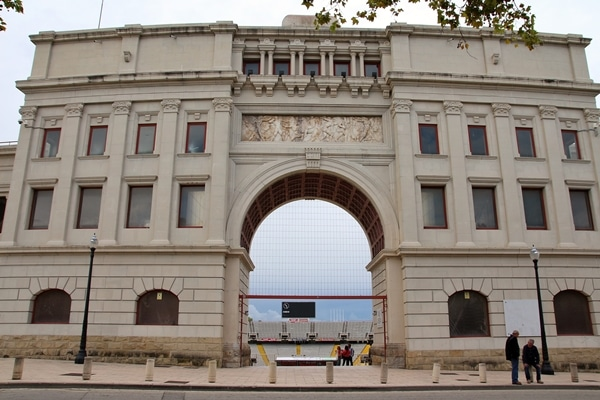 A large stone archway leading into the Olympic stadium