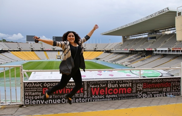 a woman jumping inside an Olympic stadium