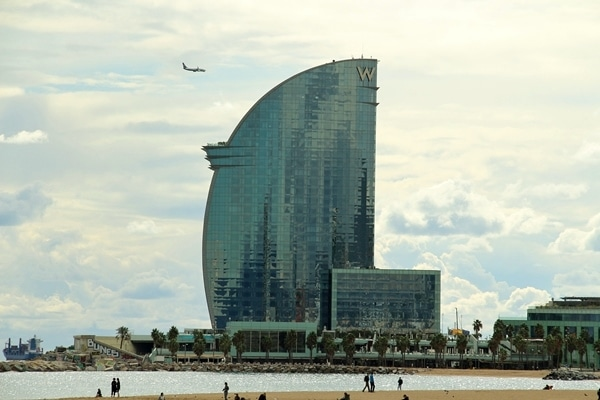 closeup of a glass-covered hotel building on the beach