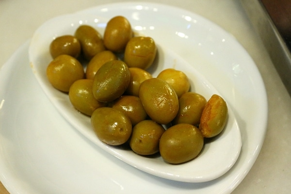 A plate of green olives