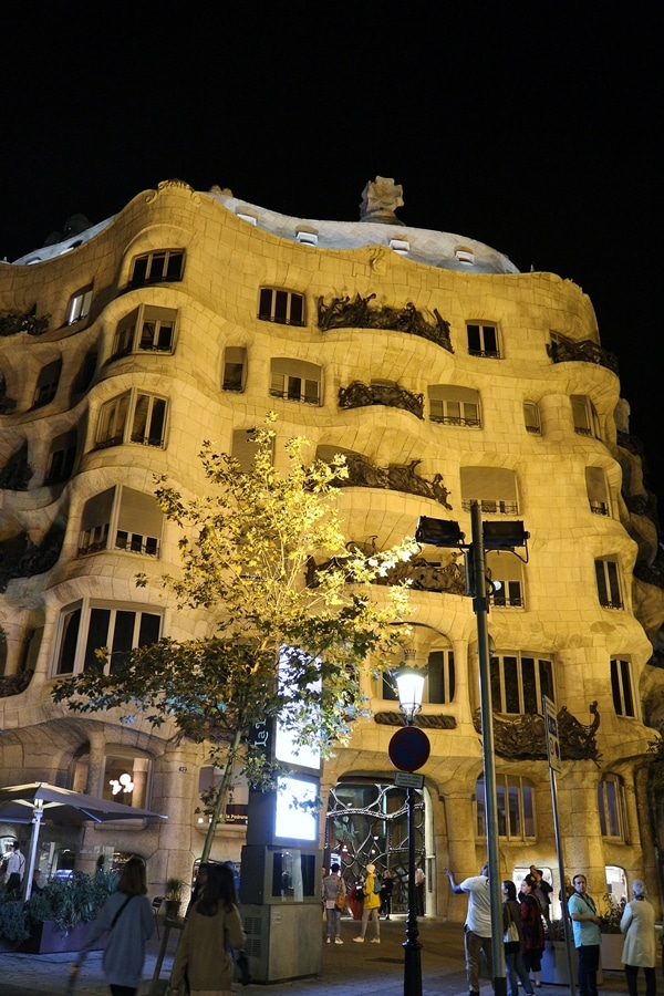 wide view of Casa Milà at night