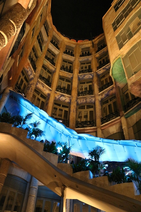a nighttime view inside an open courtyard