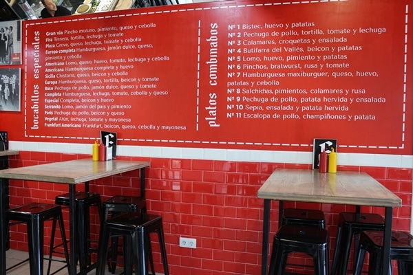 a menu on a red wall