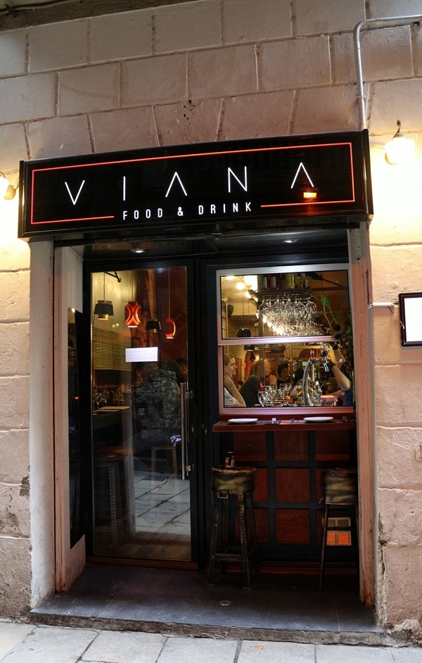 exterior of a restaurant with a sign that says Viana