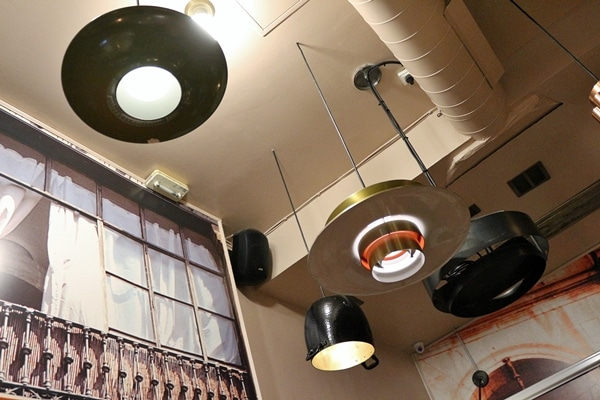funky lighting fixtures hanging from a restaurant ceiling
