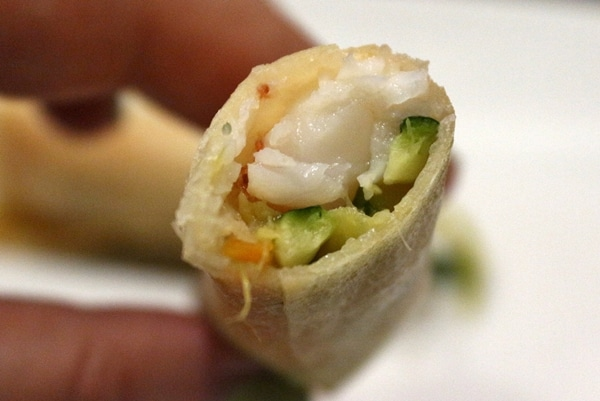 A close up of a half-eaten spring roll