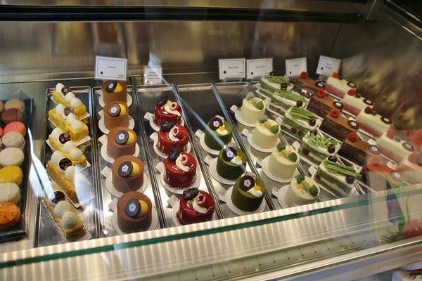 A display case filled with fancy desserts