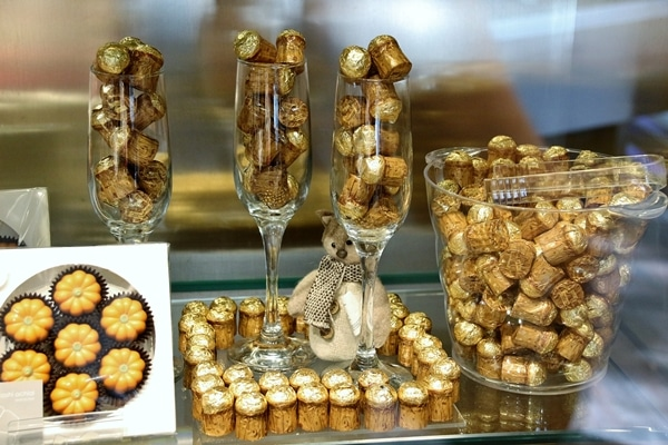 a display of chocolates that resemble Champagne corks