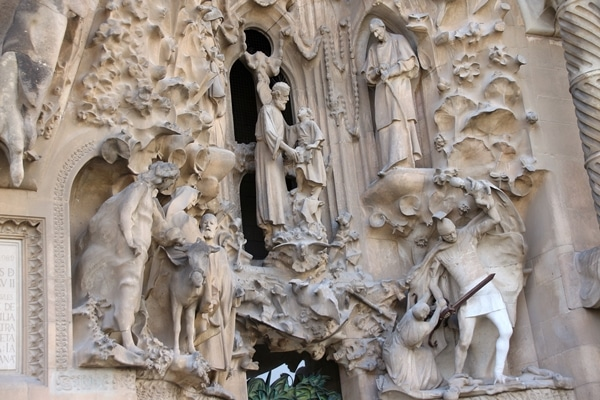 religious carvings on the stone exterior of Sagrada Familia church