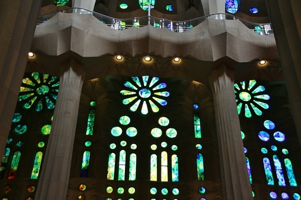 green and blue stained glass windows inside a church