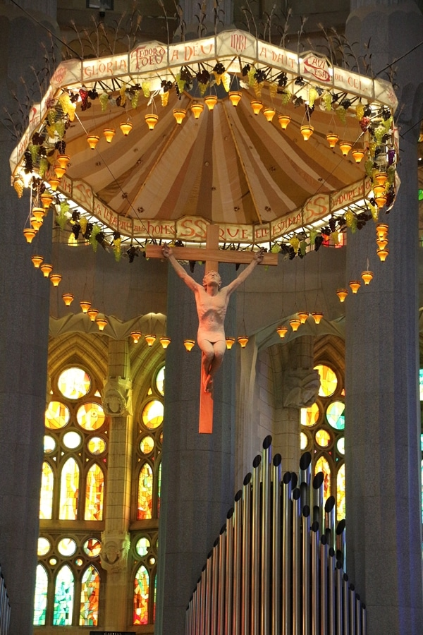 a crucifix hanging over the altar in a church