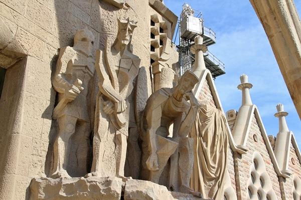 several stone cubist statues outside Sagrada Familia