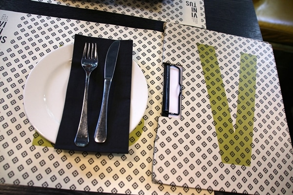 A close up of a table setting in a restaurant