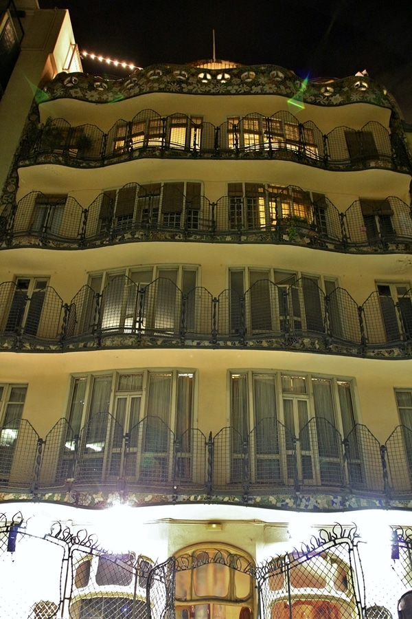a building with balconies at night