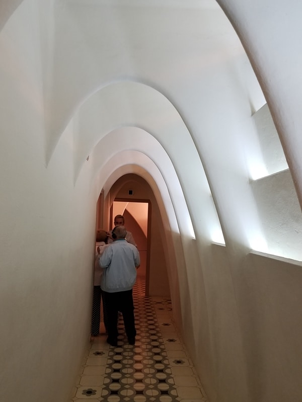 a white hallway with tall arches