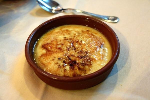 Catalan custard served in a round brown dish