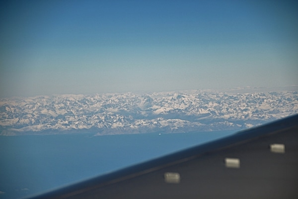 distant view of Greenland from an airplane window