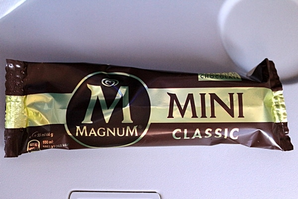 a wrapped ice cream bar on an airplane tray table