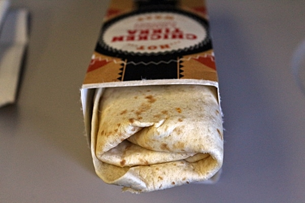 a Chicken Tikka Wrap extending out of its box