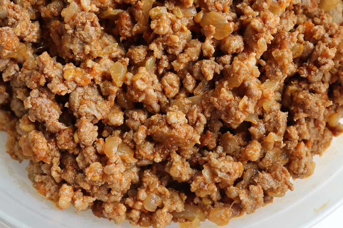 Closeup of cooked ground meat filling with onions.