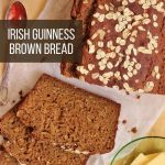 overhead closeup of a loaf of sliced Guinness brown bread with oats