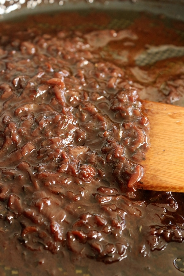 Caramelized onions in red wine reduction, in a skillet