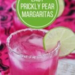 closeup of a hot pink prickly pear margarita with a lime slice garnish