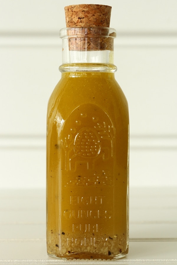A close up of vinaigrette in a glass bottle