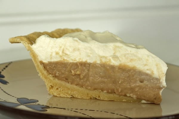 side view of a slice of Earl Grey cream pie on a plate