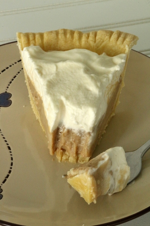 a slice of cream pie with a bite on a fork