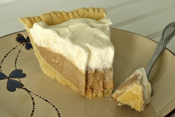 a slice of cream pie with a bite removed