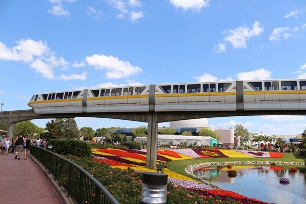 a monorail crossing over a pond at Epcot