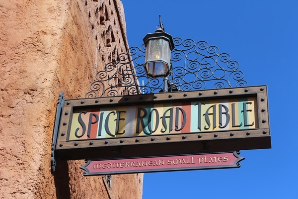 A sign on the side of a building that says Spice Road Table