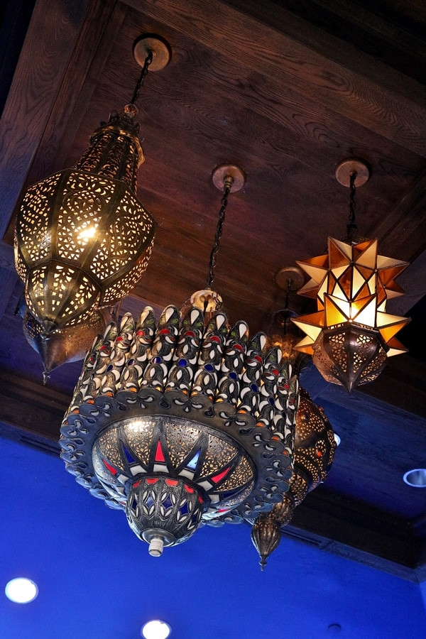 intricately decorated lighting fixtures in a restaurant