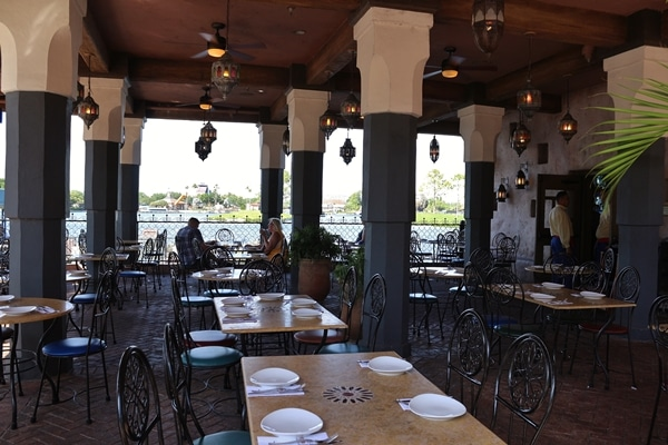 a restaurant dining room overlooking a lagoon