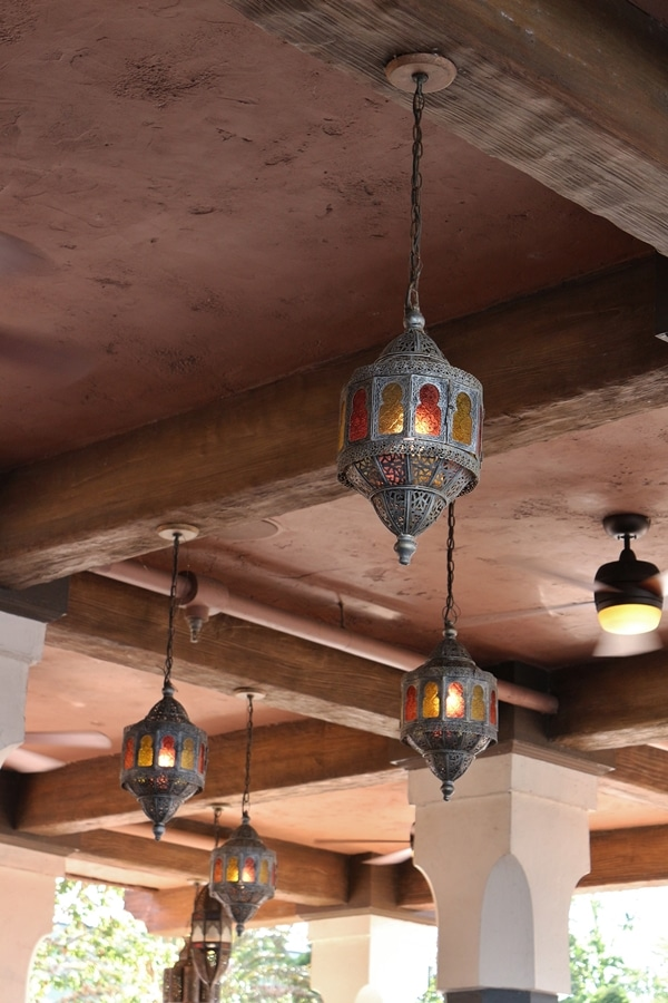 rustic lantern-style lighting fixtures hanging from the ceiling