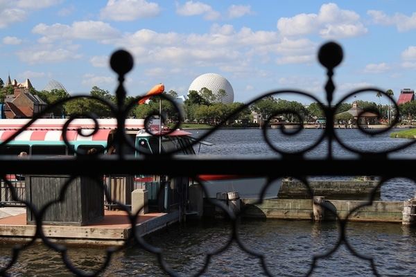 view of Spaceship Earth at Epcot through a metal fence