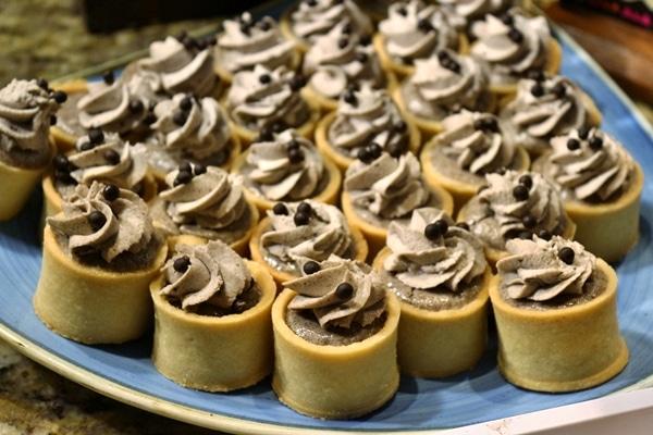 a platter of bite-size desserts
