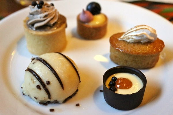 a plate of bite-sized desserts