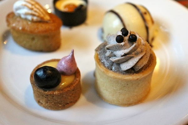 A close up bite-sized desserts on a plate
