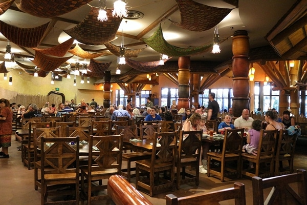 many tables and chairs in a restaurant dining room