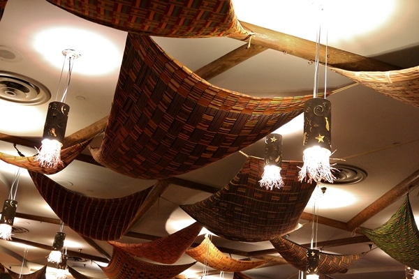 colorful fabrics hanging from the ceiling