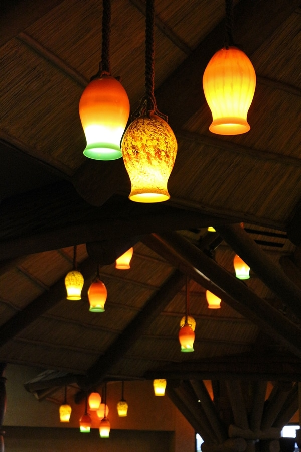 colorful lighting fixtures hanging from the ceiling