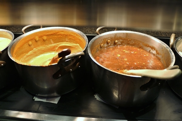 2 pots of food on a buffet